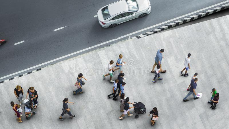 People walk on the pedestrian street walkway with the teenage yo. Ung man and the group of family with little child with road and car transport. Aerial urban royalty free stock photos
