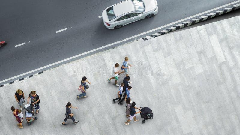 People walk on the pedestrian street walkway with the teenage yo royalty free stock image