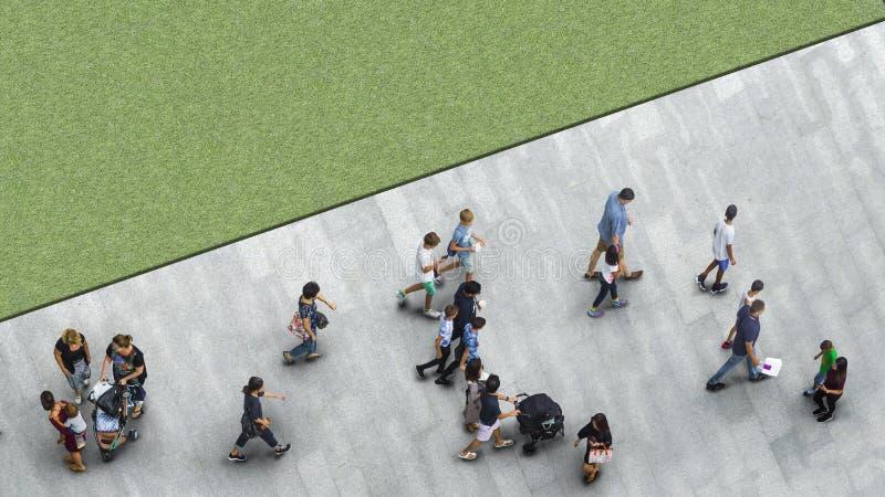 People walk on the pedestrian street walkway with the teenage yo royalty free stock photography
