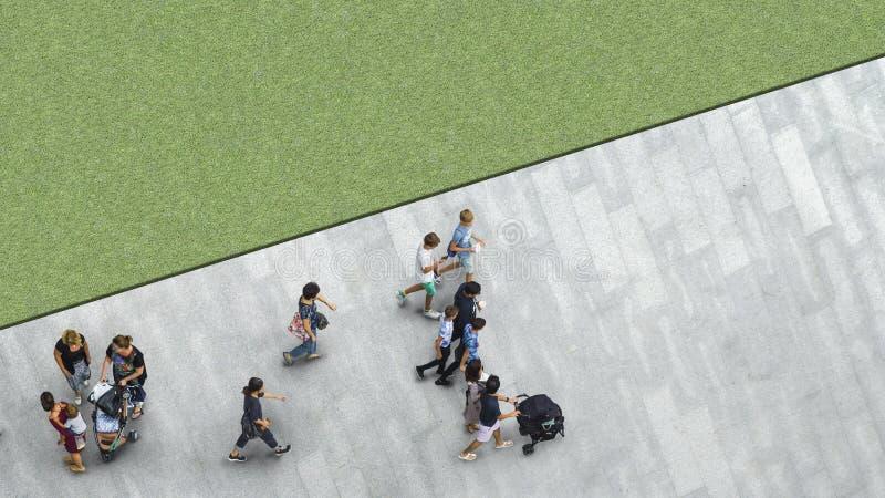 People walk on the pedestrian street walkway with the teenage yo stock photo