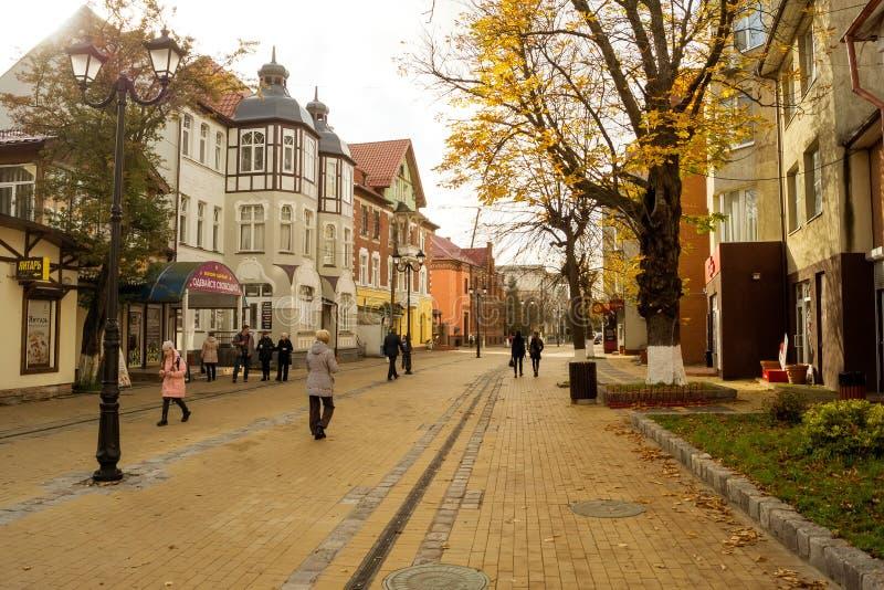 People walk on a pedestrian street in Zelenogradsk. ZELENOGRADSK, KALININGRAD REGION, RUSSIA - OCTOBER 18, 2017: People walk on a pedestrian street in stock image