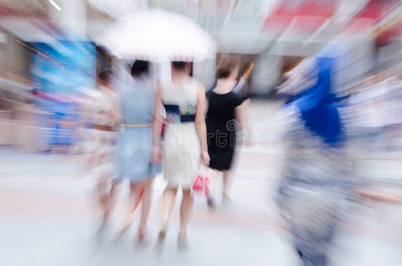 People walk in the street stock photo