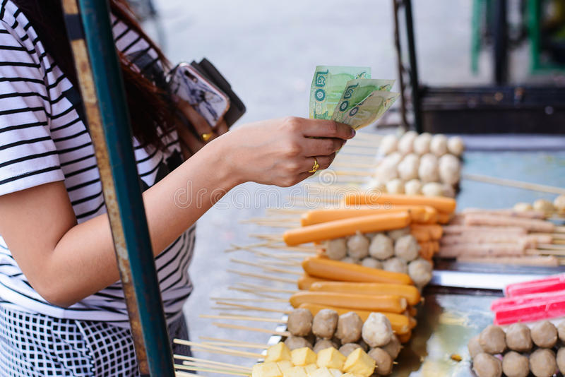 People walk on street for buy thai meat ball and sausage. With bamboo stick, Thai food on street food royalty free stock photography