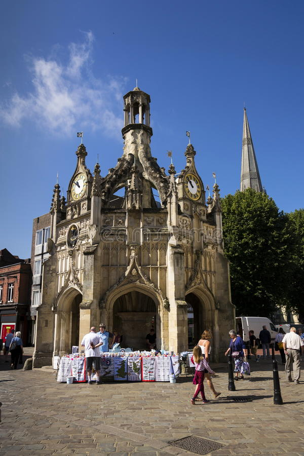 People walk on street in front of the Chichester Cross on August 12, 2016 in Chichester, United Kingdom. CHICHESTER, UNITED KINGDOM - AUGUST 12: People walk on royalty free stock images
