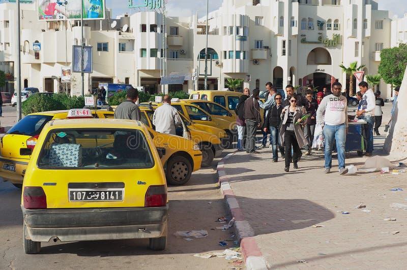 People walk by the street in Sfax, Tunisia. SFAX, TUNISIA - NOVEMBER 30, 2011: Unidentified people walk by the street in Sfax, Tunisia royalty free stock image