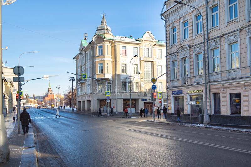 People walk at Volhonka street in winter day. MOSCOW, RUSSIA - JANUARY 25, 2019: people walk at Volhonka street and view of Kremlin in winter day. Volkhonka is stock photo
