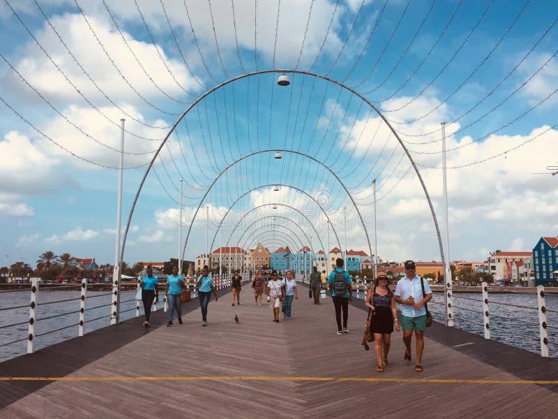 People walkin over the floating bridge Queen Emma bridge in W royalty free stock photos