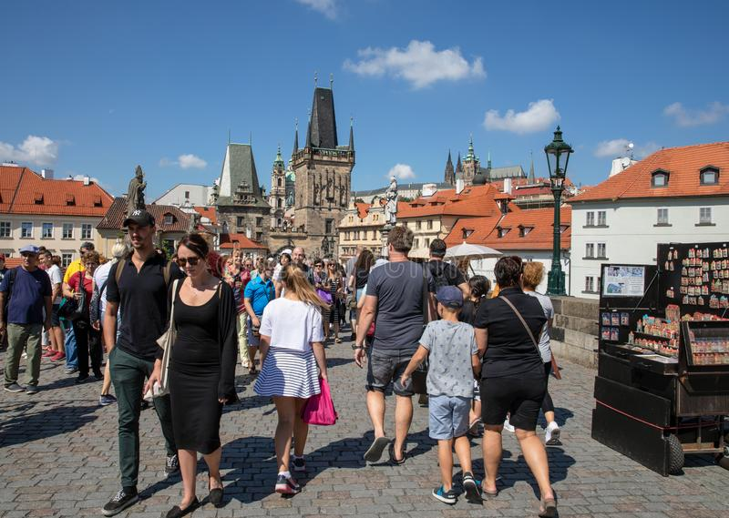 People walking across the Charles Bridge in Prague stock images