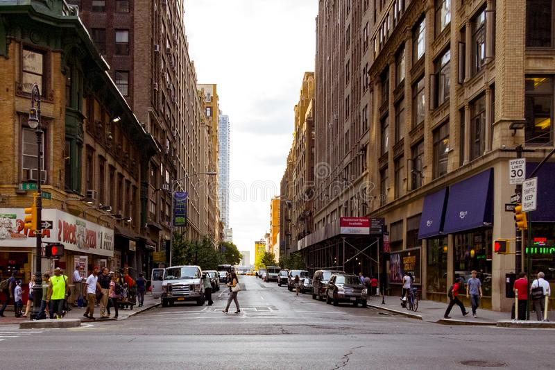 People Walking on Alley Surrounded by High Rise Buildings stock image