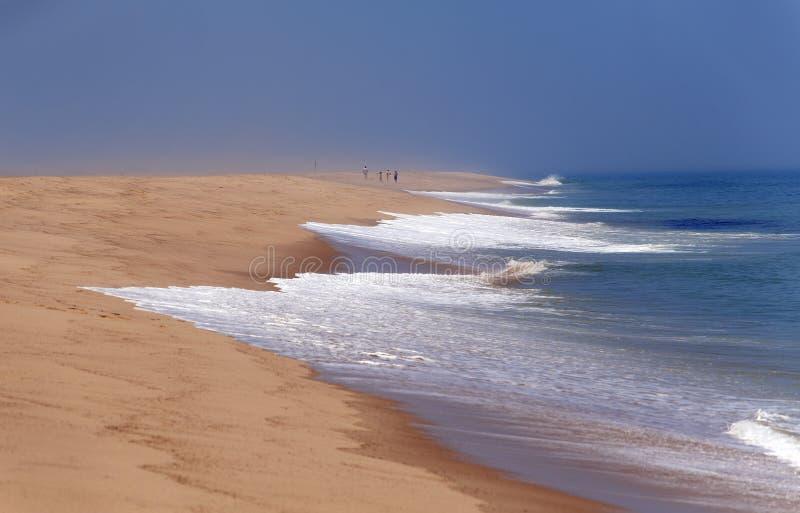 People walking along the beach