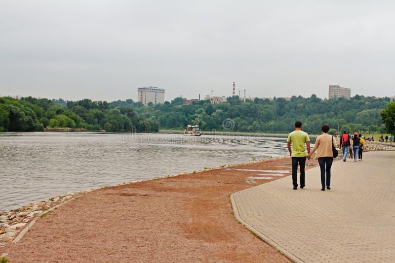 People walking along the embankment royalty free stock image