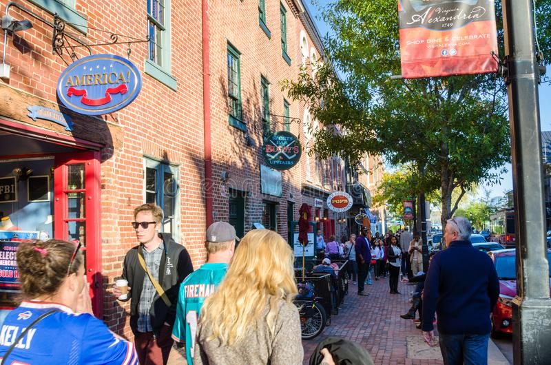 People walking along King Street in Old Town Alexandria on a Sunny Autumn Day royalty free stock images