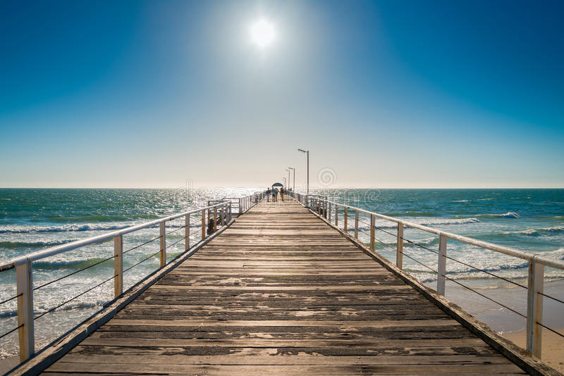 People walking along the pier royalty free stock photography