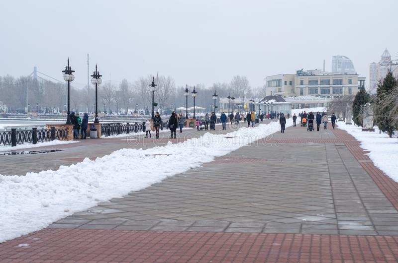 A people walking along the waterfront in winter stock photography