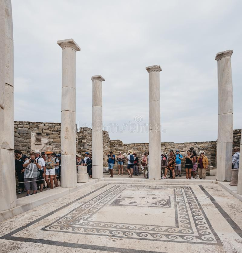 People walking around House of Dionysos ruins on the island of Delos, Greece stock images
