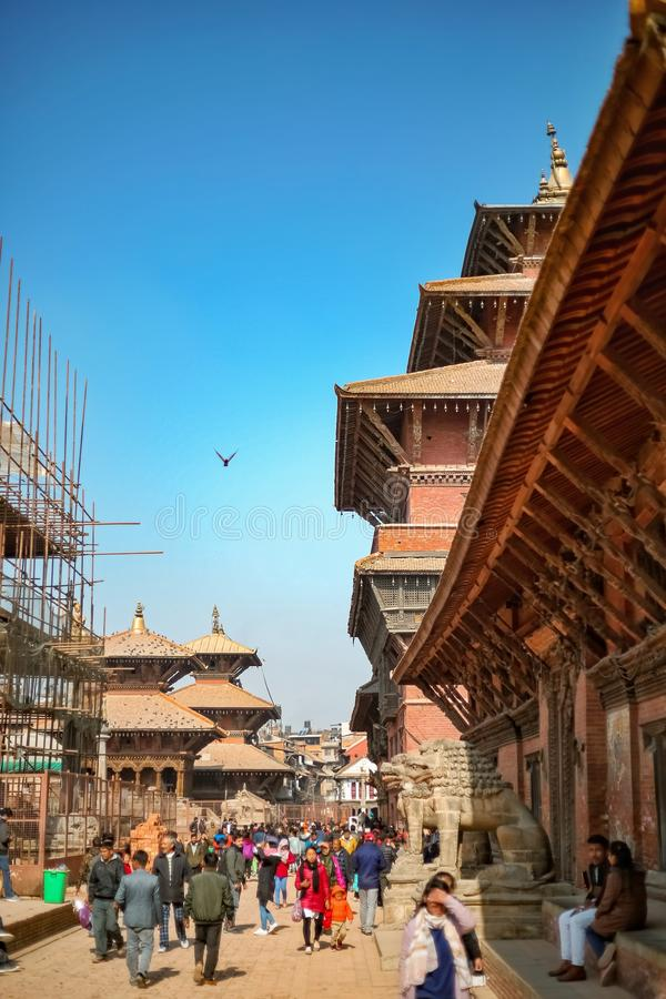 People walking around Patan Durbar Square, a UNESCO Heritage site in Nepal stock images
