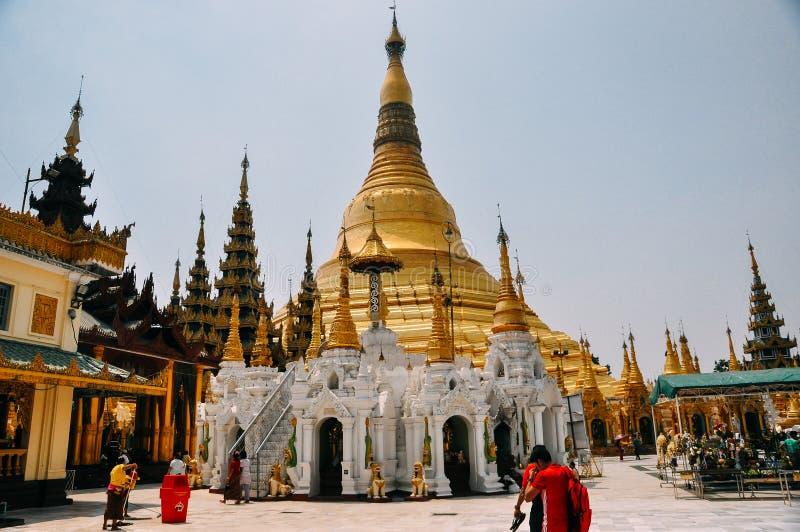 People walking around at Shwedagon Pagoda in Yangon. royalty free stock images
