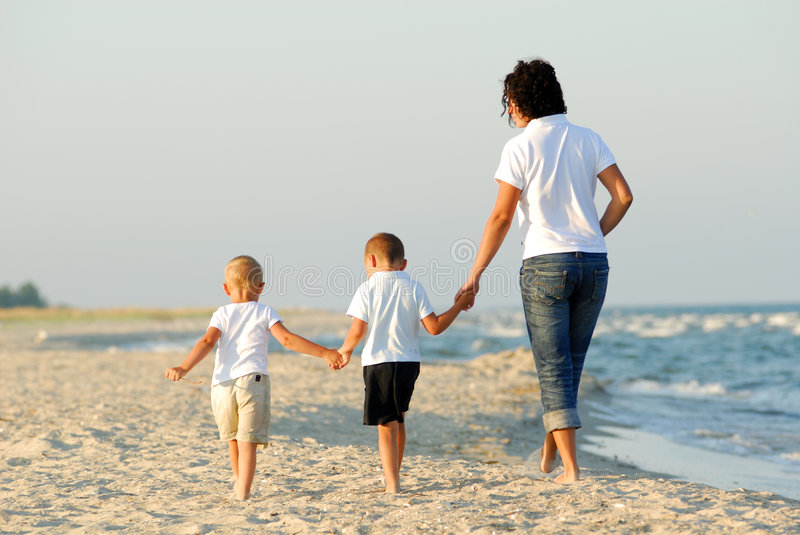 People walking on beach royalty free stock image