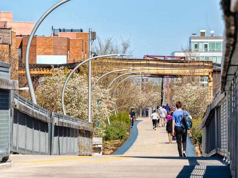 People walking on The 606 Bloomingdale Trail near Western Avenue. Streets of Chicago royalty free stock photography