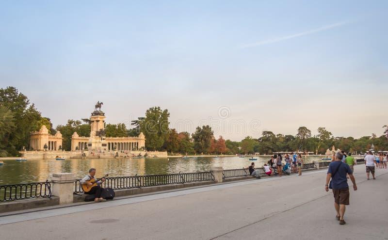 People walking in Buen Retiro park lake, Madrid stock image