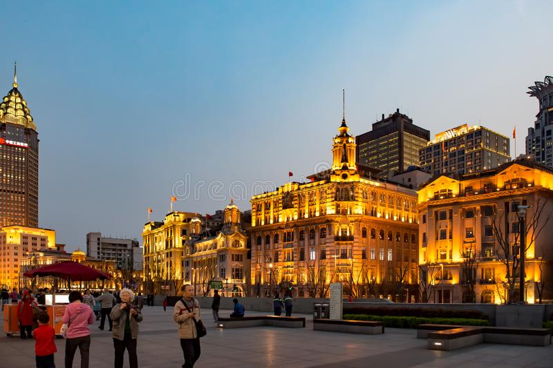 People strolling at night over the Bund Shanghai, China stock photography
