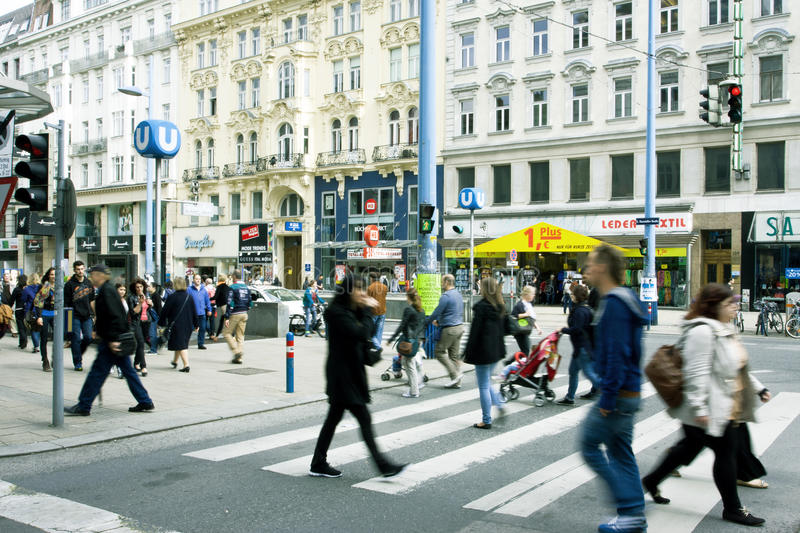 People walking through the central street. Many people walking through the central street of Austrian capital in Vienna Austria. Population of Vienna is about 1 royalty free stock image