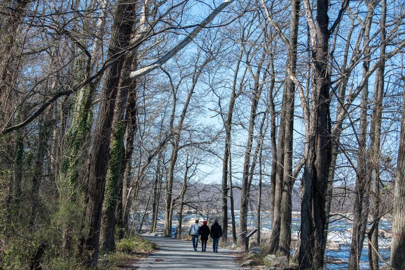 People walking on a clear warm March day in Richmond, Viginia royalty free stock photo