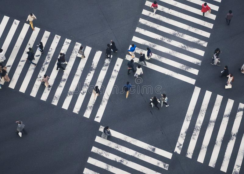 People walking Crossing Sign street Top view City social diversity stock images