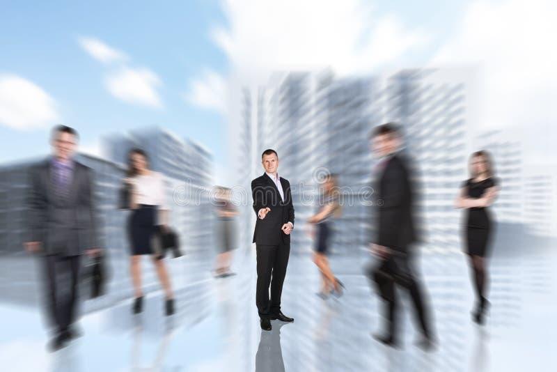 People is walking in defocused big city stock image