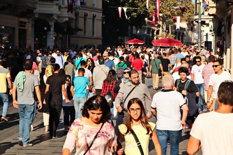 People walking down Istiklal Caddesi street in Istanbul. ISTANBUL, TURKEY - Sep 16, 2019: People walking down Istiklal Caddesi street in Istanbul. This is a royalty free stock image