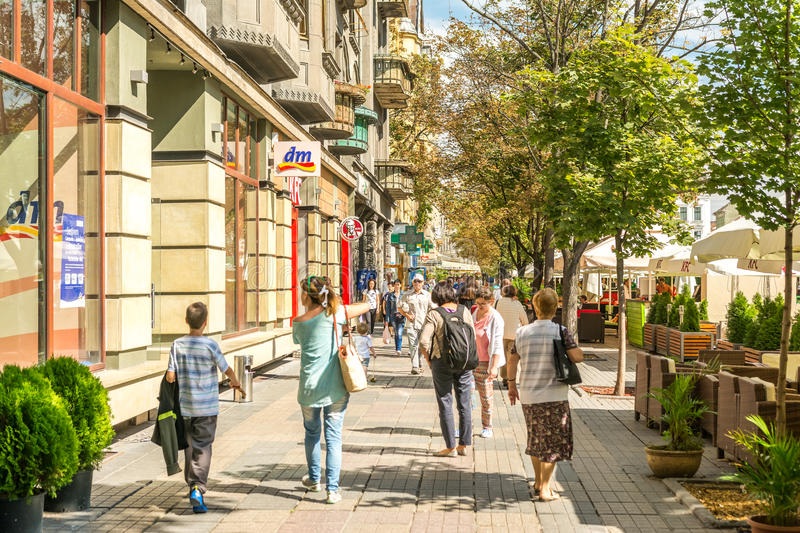 People Walking Downtown The Historical Center Of Timisoara. TIMISOARA, ROMANIA - AUGUST 25, 2014: People Walking Downtown The Historical Center Of Timisoara City royalty free stock photo