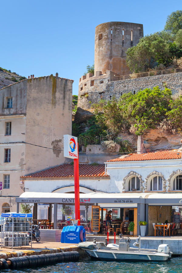 People walking on embankment of port town, Corsica royalty free stock photos