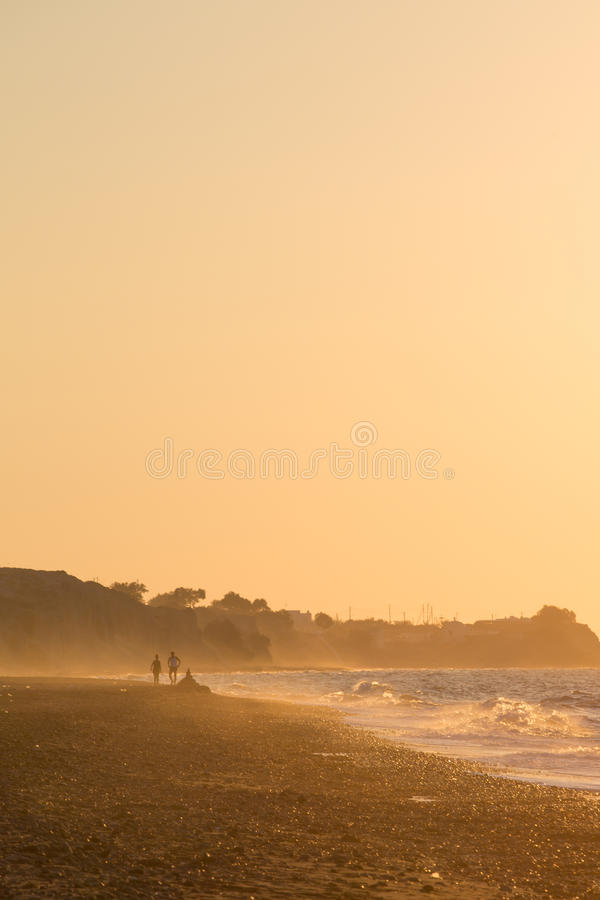 Download People Walking And Enjoying The Beach And The Sunset Stock Image - Image: 34400829