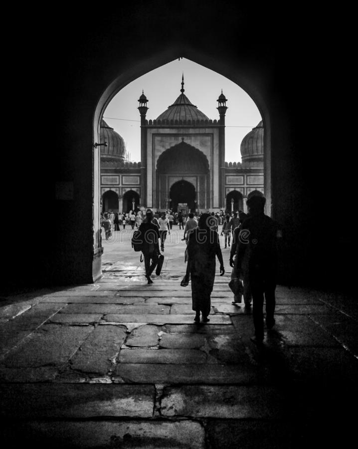 People walking by the entry of Jama Masjid stock images