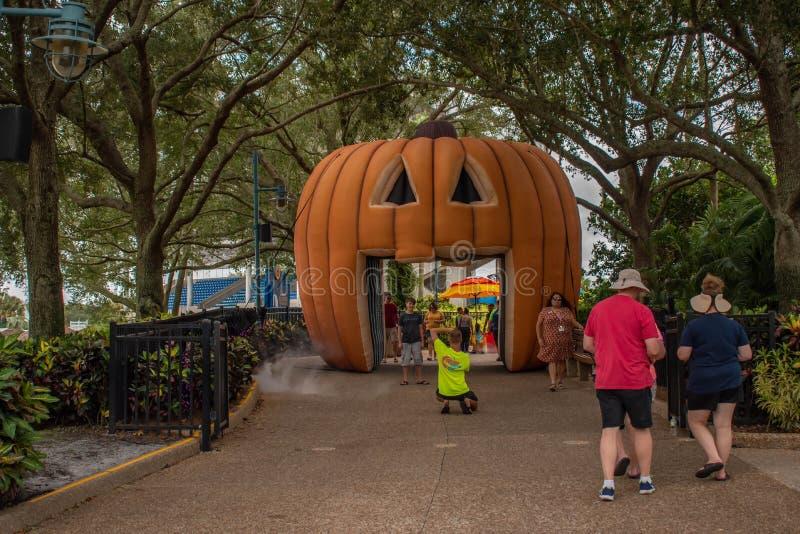 People walking in giant pumpkin tunnelat Seaworld 153. Orlando, Florida. September 21, 2019. People walking in giant pumpkin tunnelat Seaworld 153 royalty free stock photo