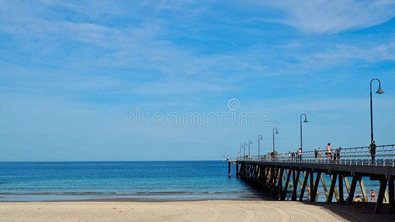 People walking on Glenelg Jetty stock images