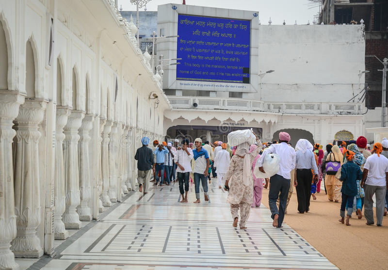 People walking at Golden Palace in Amritsar, India royalty free stock photo