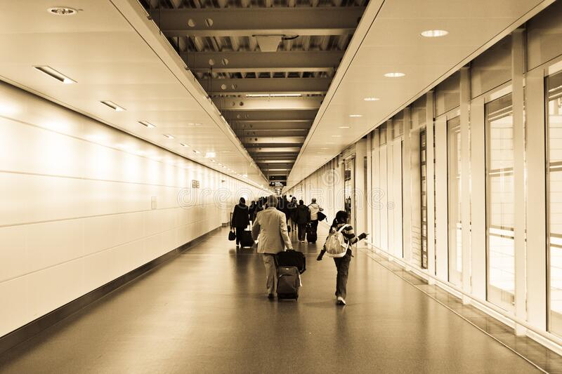 People Walking in the Hallway Inside the Building royalty free stock images