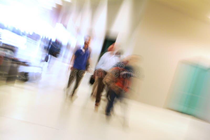 People walking indoor. Movement and blur