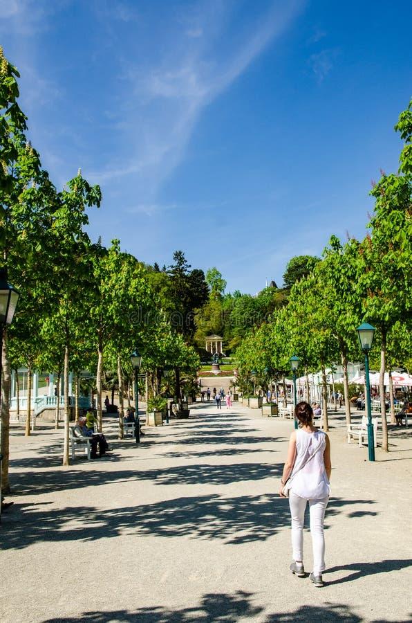 People walking in Kurpark park near casino, sunny day royalty free stock photography