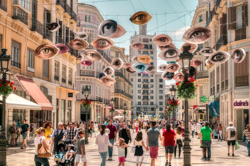 People walking on the Marques de Larios pedestrian, Malaga, Spain royalty free stock images