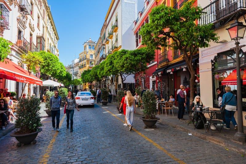 People walking Mateos Gago street in Sevilla. stock photos