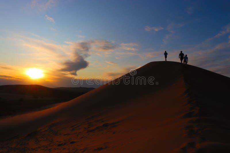 People walking on mongolian dunes royalty free stock photography