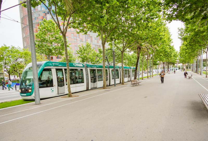 People walking in the morning to the work and a tram passing in stock photography