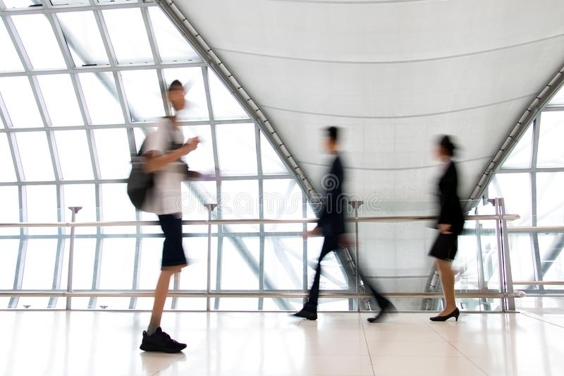 A people walking in motion blur on white corridor stock photo