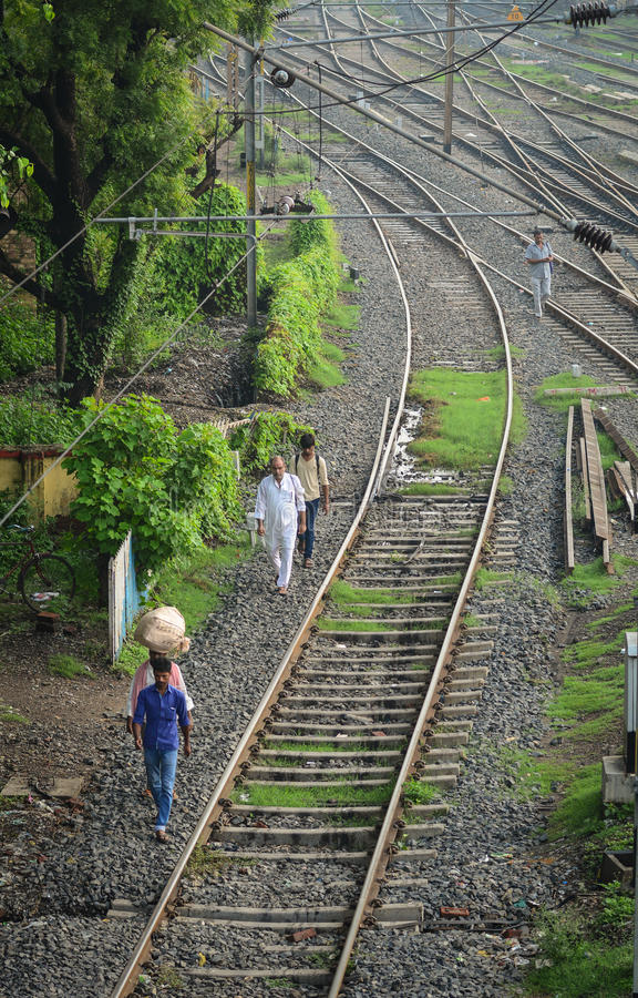 People walking near rail tracks in Agra, India stock photos