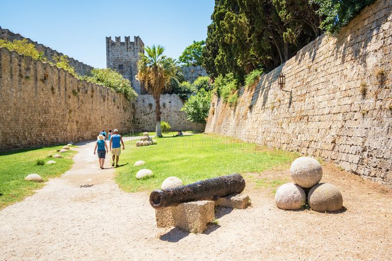 People walking next to Grand master palace in old town of Rhodes royalty free stock images
