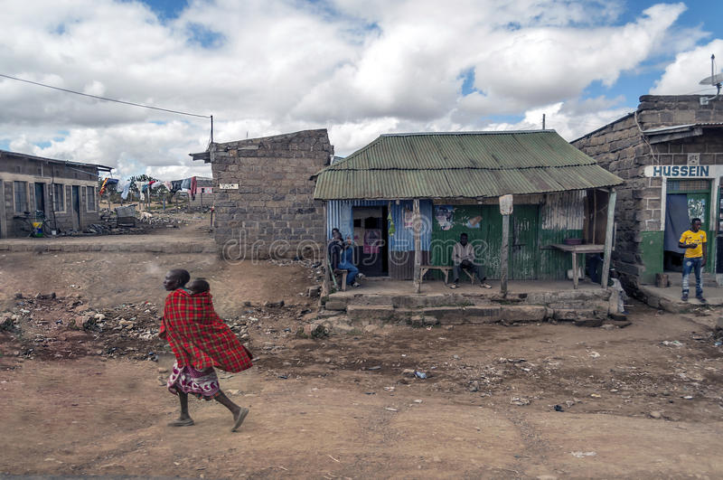 People walking outside a bar. In Kenya , picture taken in May 2014 on a sunny day stock photo