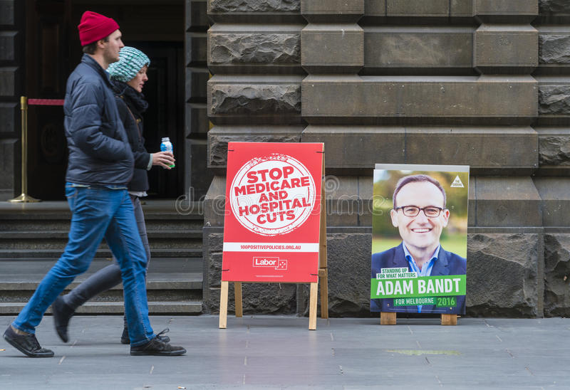 People walking pass polling place in Melbourne during Australian federal election 2016 royalty free stock photos
