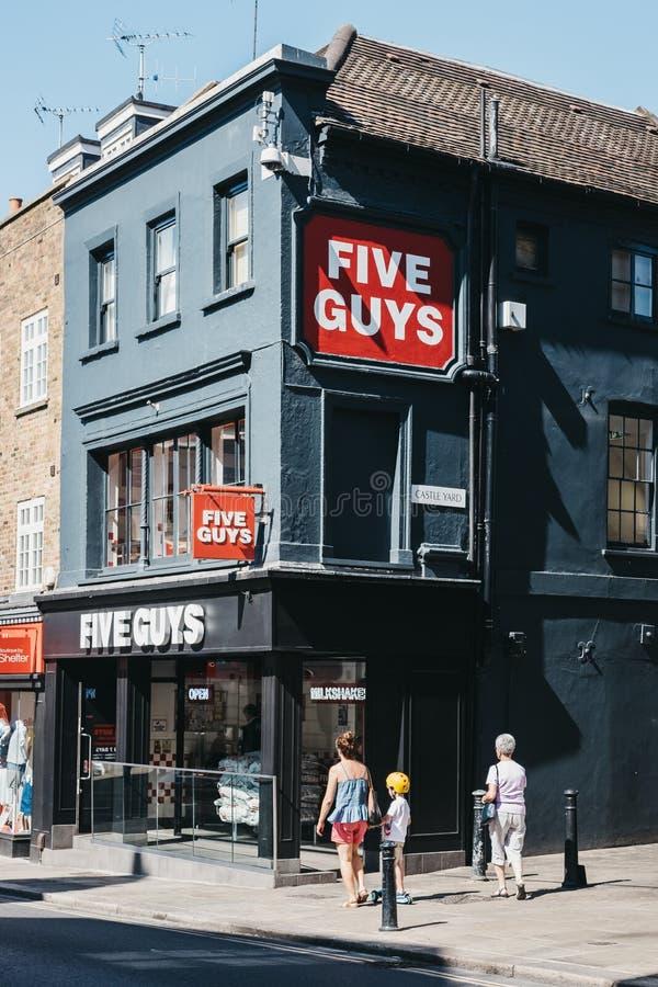 People walking past Five Guys restaurant in Richmond, London, UK stock photos